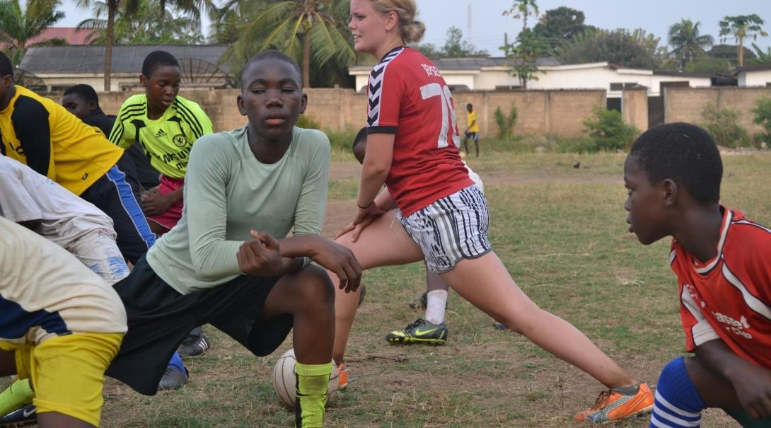 A Projects Abroad volunteer warms up before teaching football in Ghana